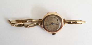 Old 9ct gold lady's wristwatch, by Texina, with spring loaded expanding braceletCondition Reportno