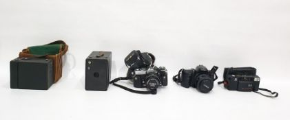 Collection of cameras and lensesto include two box cameras, one in brown canvas bag, a Minolta