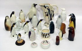 20th century group of porcelain, pottery, glass and wood models of penguins, the tallest 22.2cm
