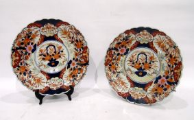 Pair of Imari chargers, each painted with a central cartouche and jardiniere of flowers, the borders