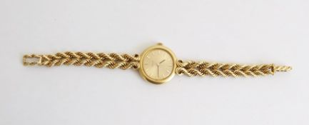 Lady's 18ct gold Omega dress watchwith gold-coloured dial, baton markers, with a ropetwist bracelet