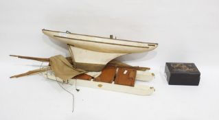 Wooden modelof a sailing boat, 53.2cm long,a group of lacquer boxesin sizes, gilt with scrolling
