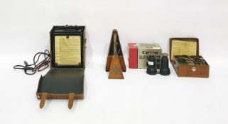 Avometer, model no.40, cased, a Megger circuit testing ohmmeter, cased, a metronomeby Maelzel,