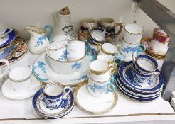 Booths Pottery 'Real Old Willow' pattern part tea service to include four tea cups, a coffee can,
