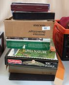 Quantity of puzzles, vintage and other games, boxed doll's china teaservice etc.