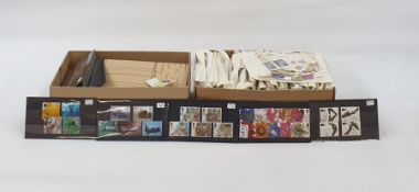 Two boxes of loose stamps, GB used on stock cards and partly filled approval books (2 boxes)