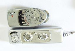 Minox Wetzlar Complan 1:3,5 metal cased miniature folding camerain leather case and a Leica light