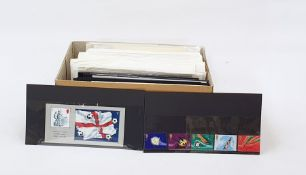 Box of First Day Covers and mint British decimal stamps, face value well over £100