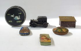 A quantity of tea and biscuit tins, to include a vintage black car shaped tin, two tin money