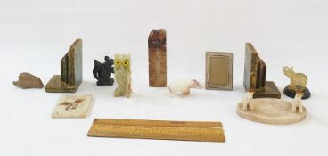 Quantity of stone, alabaster and onyx, carved models of animals, a pair of stone bookends modelled