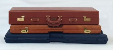 Giubileo hide covered gun case made in Italy, a Browning gun case and another Italian plastic gun