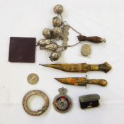 Assorted items to include white metal Brazilian, metal Eastern daggers, etc (1 box)