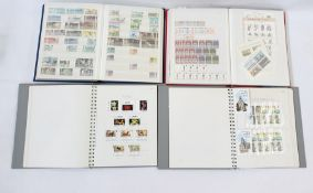 Box of eight albums and stock books of mainly used Guernsey, Jersey and Isle of Man stamps
