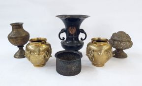 Quantity of Eastern brass and metalware, to include a pierced footed bowl and cover, cast with a