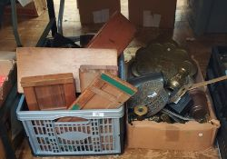 Box of metalware and a box of treen to include miniature pierced black back rocking chair, pair of