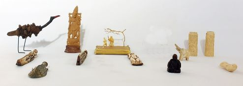 A collection of Asian sculptures, to include two Japanese carved ivory handles carved with