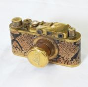 Replica Leica I Luxus cameraserial number 17458 with gilt body and faux-snakeskin cover