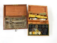 A brass minocular microscope in box, set of scalpels in removable tray in brass and mahogany box and