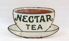 A metal enamelled nectar tea advertising sign, in the form of a teacup and saucer, in white and