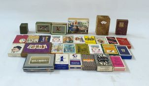 A collection of boxed playing cards, card games, dominoes, a tin case set of patience and an Italy