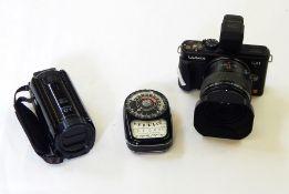 Lumix Panasonic DMC-GX1 camera, a Canon Legria HFR606 hand-held video camera and a Weston Master III