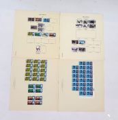 Many album leaves in protectors with stamps of a variety of countries and sheets of GB