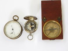 Antique wooden cased pocket compasswith printed dial, a brass cased pocket stopwatchand an E D