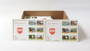 Eight boxes of Channel Islands and Isle of Man First Day Covers, most unaddressed, many hundreds (