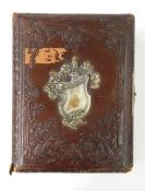 Victorian photograph album containing portraits and group shots and another metal bound embossed