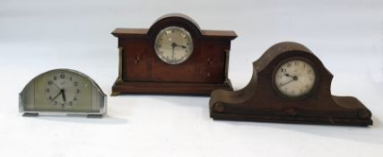 A comet 8 day alarm clock,two mantle clocks and two wooden mounted mantle clocks, one an Elliott