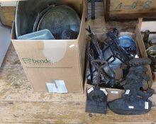 Two boxes of assorted metalwares together with two cast iron doorstops, decorative items, etc (2