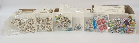 Two boxes of loose stamps of the world, box of stamps on paper and a large black bag and British