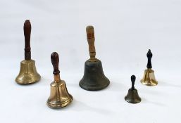 """Five brass and metal hand bells, with turned wooden handles, one incised """"10"""", the tallest bell 29cm"""