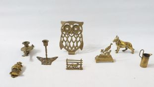 Quantity of brassware to include a pair of candlesticks, models of dragons, a pair of candlesticks