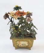 A Chinese jade stone, quartz, mother of pearl, mounted flowering tree in a brass rectangular section