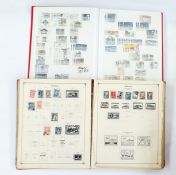 Seven albums and two stock booksincluding Scott international postage stamp album, circa 1930
