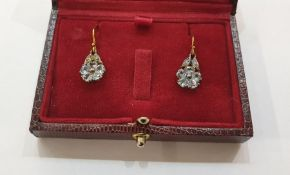 Pair of yellow gold-coloured metal, topaz and diamond earrings, each flowerhead set with five