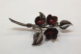 Charles Horner silver and coral spray brooch, the three flowerheads each set with central coral bead