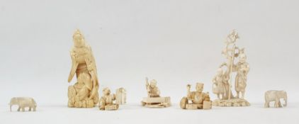 Chinese carved ivory okimono in the form of man with turtle, boy seated at his feet, 10cm high; a