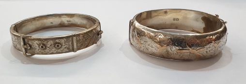 Silver bangle of belt and buckle design with scroll engraving and another silver gold applied