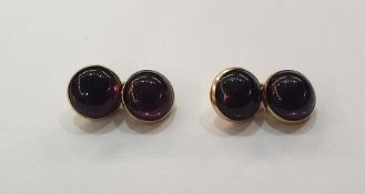 Pair of gold coloured metal and cabochon amethyst cufflinks, each double circle