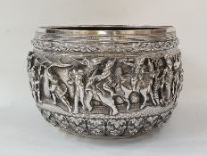 19th century Burmese silver bowl decorated with warriors, elephant, oxen and figures in boat (some