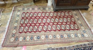 20th century Persian rug, the red ground central field with three rows of 13 elephant foot cream