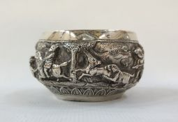 Burmese small bowl decorated with figures and wild animals, including lions and tigers, in relief,