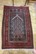 Persian prayer rug, the black ground central field with repeating pattern, on a stepped border,