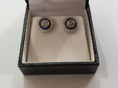 Pair of 18ct white gold, old-cut diamond and sapphire stud earrings, target-pattern, the centre