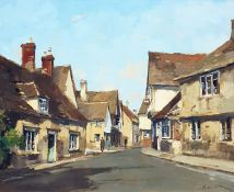 """Stanley Orchart Oil on board """"Evening Light at Lacock"""", signed lower right, bears label verso,"""