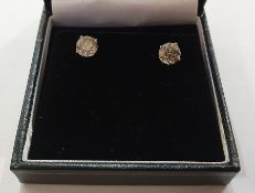 Pair 18ct white gold and diamond stud earrings, each circular claw set, 3.07ct total approx