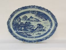 Chinese porcelain shallow dish, oval with everted rim, pagodas in lakeside landscape painted in
