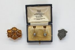 Antique pinchbeck and citrine brooch, shaped oval, set with seven oval cut claw-set stones, in